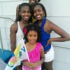 My nieces and daughter posing with the Virgin Islands flag after the parade.