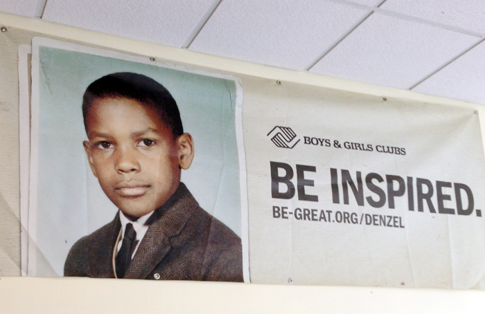 A banner featuring a young Denzel Washington at the Brookhaven Boys & Girls Club.